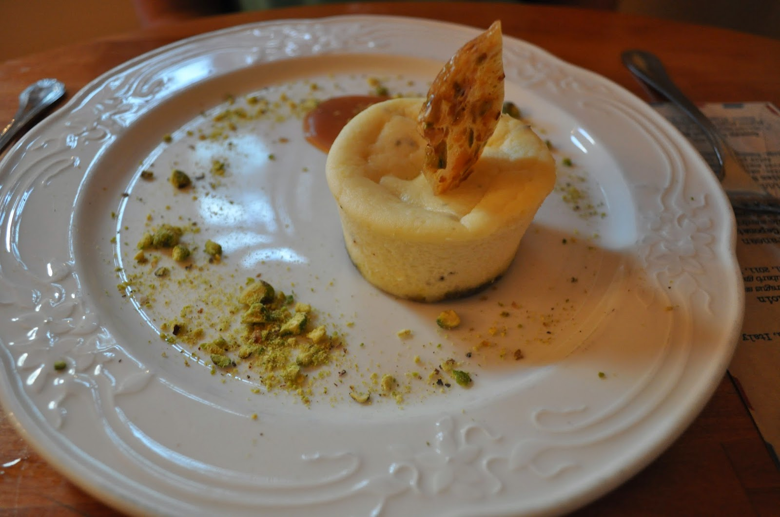 ... Ricotta Cheesecake. Pistachio crust, nut brittle, honey sauce