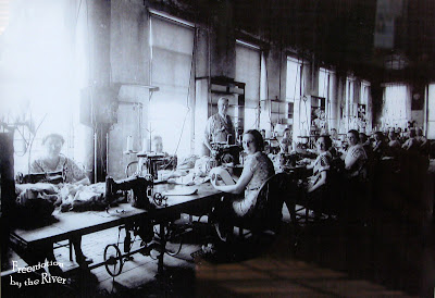 Women sewing on treadle sewing machines in Bonaparte Iowa
