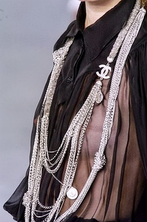 Chanel runway details: black sheer blouse and necklaces