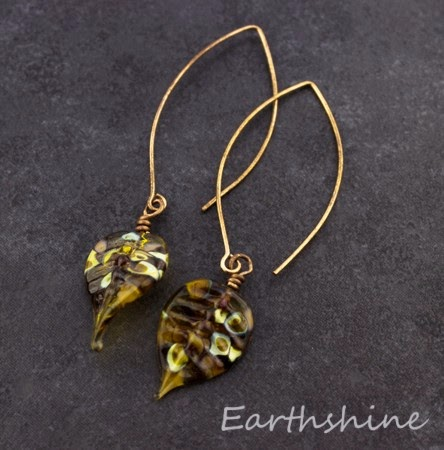 http://earthshine.indiemade.com/product/copper-earrings-lampwork-glass-leaves?tid=2