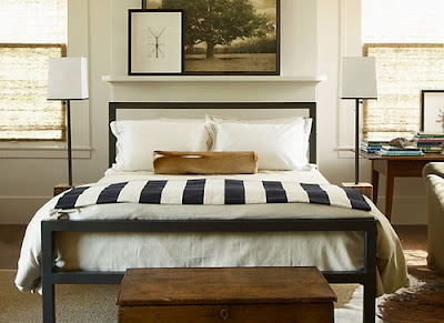 striped bedding, masculine bedroom, tailored bedding, warm interiors, art in the bedroom