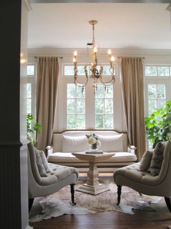 living room with gray slipper chairs