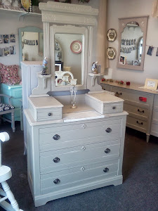 Antique dresser with attached mirror