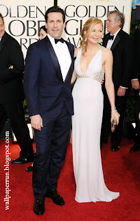 Actor Jon Hamm (L) and actress Jennifer Westfeldt arrive at the 68th Annual Golden Globe Awards in Beverly Hills