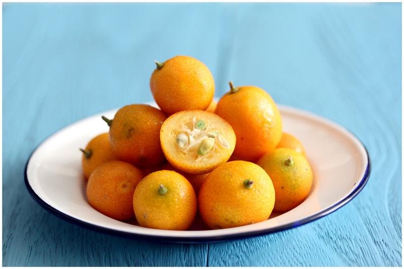 Sliced kumquats to make vanilla bean candied kumquats