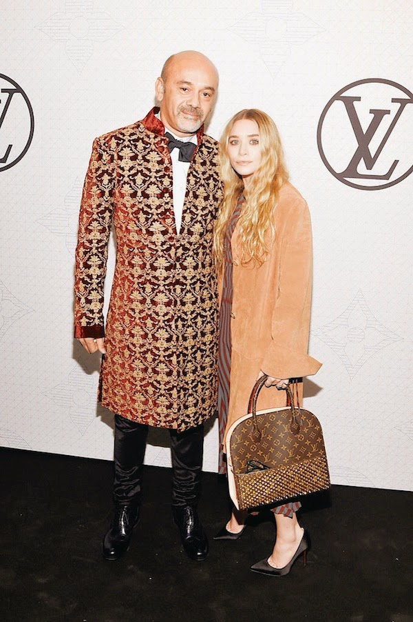 Ashley Olsen with Christian Louboutin in Rohit Bal Gold and wine velvet sherwani coat with all over embroidery at Louis Vuitton Iconoclast launch 7th November 2014 New York City