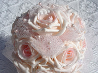 Pale pink roses (a caketopper) on white lace