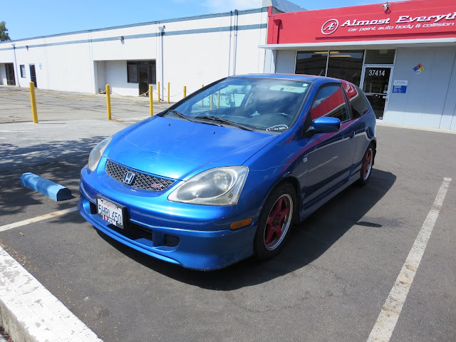 Honda Civic Si before repairs and paint at Almost Everything Auto Body