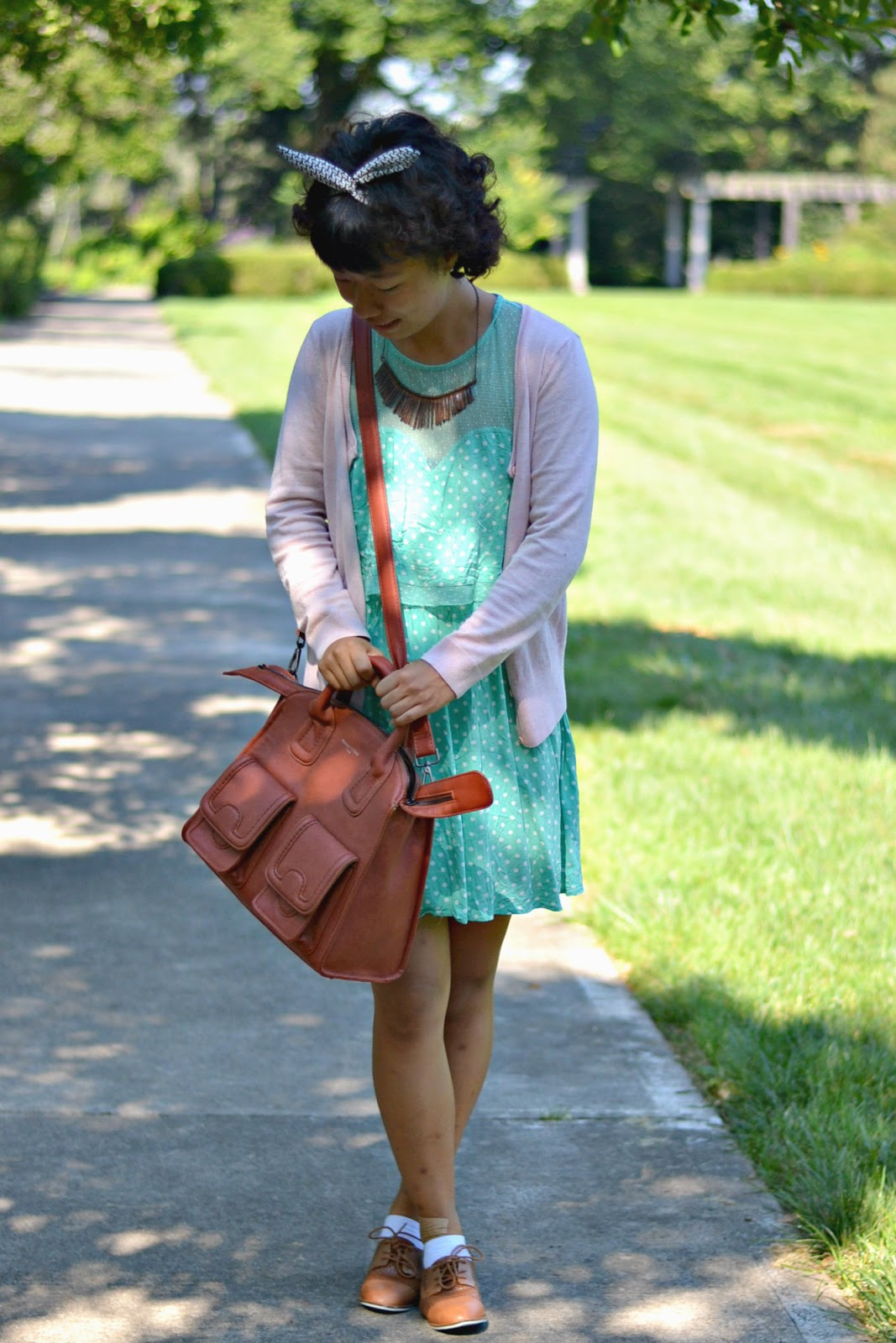 mint polkadot dress, dust pink cardi, brown shoulder bag