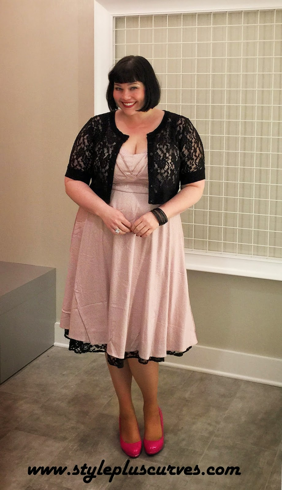 Amber from Style Plus Curves in a retro polka dot dress at the Torrid in Chicago