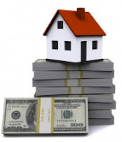 illustration of a small house atop a pile of US cash
