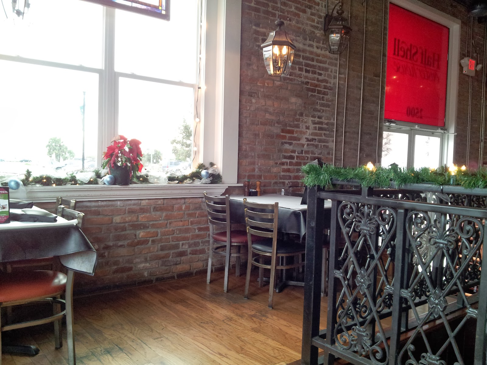 We Sat With Our Menus And Admired The Beautiful Surroundings. The Interior  Is All Hardwood, Exposed Brick And Wrought Iron. A Big Nod To New Orleans.