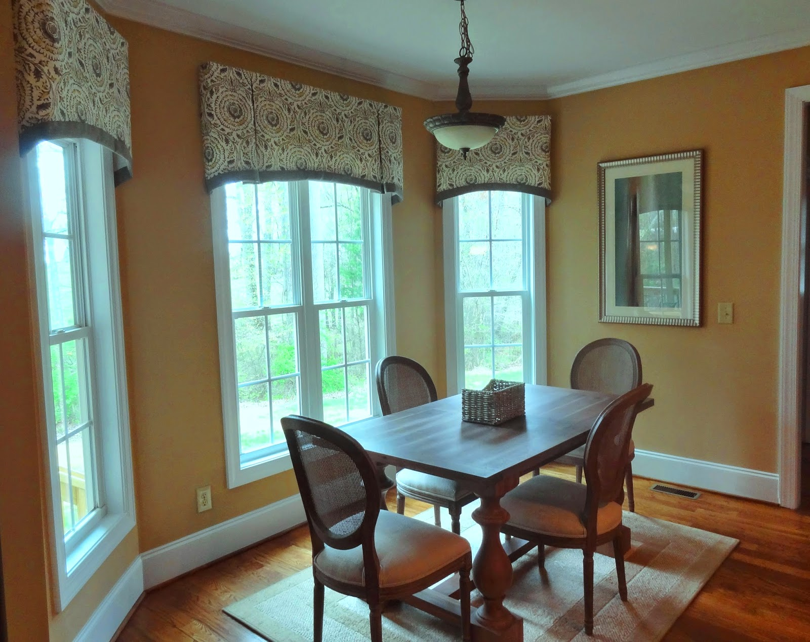 You can create the illusion of taller windows by adding window valances  (see before and after).