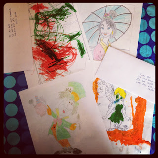 4 letters and pictures colored by kids.