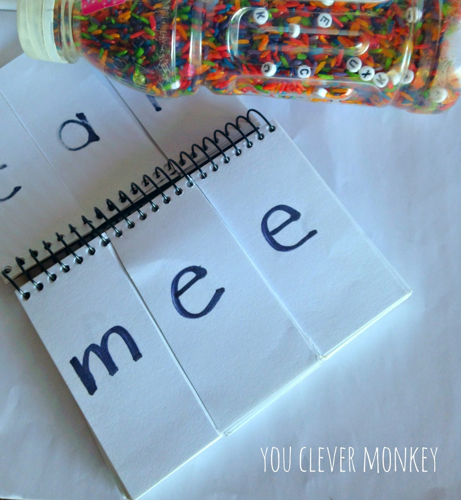 Make your own Rainbow Rice I-Spy bottle to practice early literacy skills.  See more at http://youclevermonkey.com