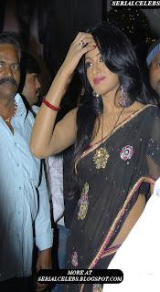 Udaya Bhanu in black low hip saree