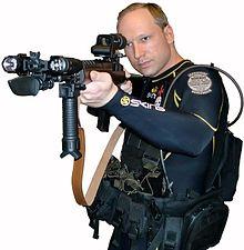 Anders Behring Breivik in diving suit with gun