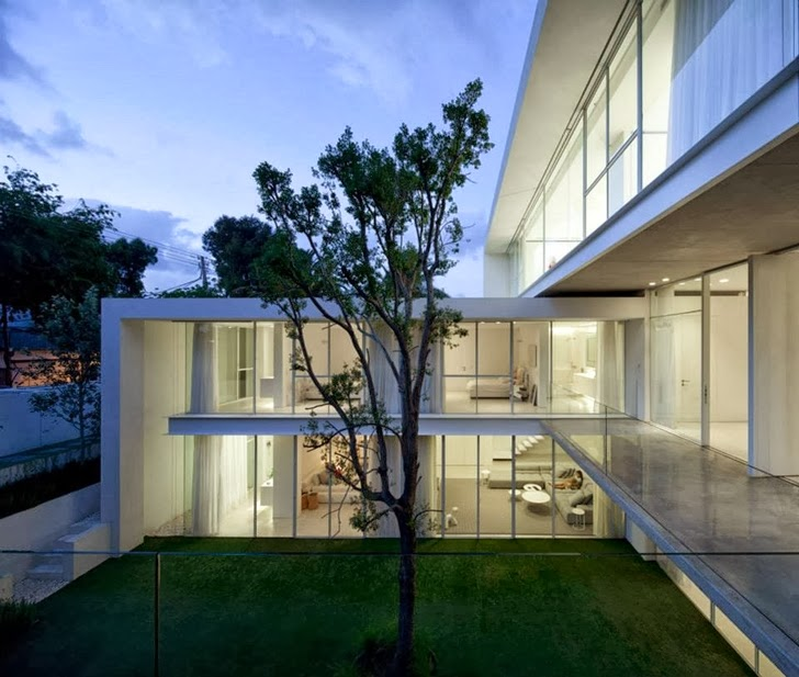Lights in White Ramat Hasharon House by Pitsou Kedem Architects
