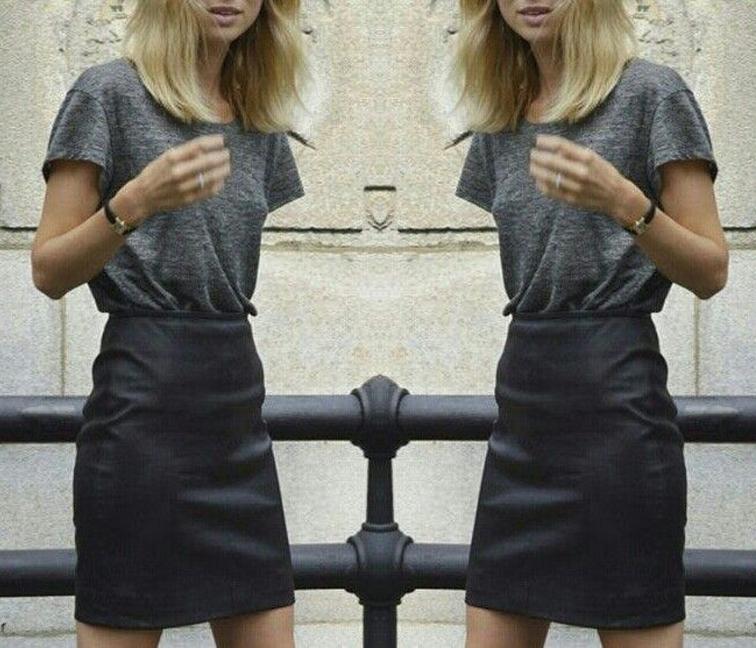 Elin Kling black leather mini skirt loose grey tee street style muse