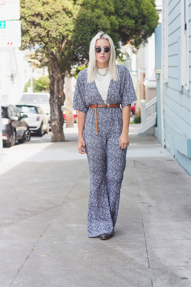 Layered Bohemian look by Bryn Newman of Stone Fox Style (San Francisco Fashion Blog). She wears a speckled plunging neckline jumpsuit with flared bottoms and layered bohemian jewels.