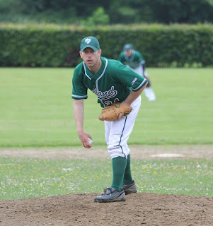 One of Ireland's national team players prepares to pitch towards home plate.