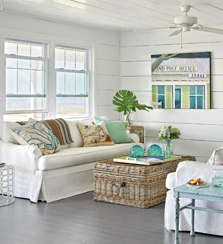 coastal cottage with white wood paneling