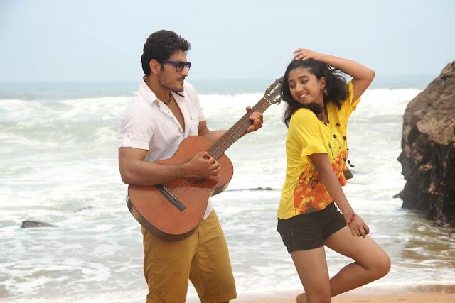 Shriya+Sharma+Ali+Reza in akudu Movie Latest Stills 7.jpg
