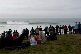 Crowds watch giant waves in Newquay Cornwall