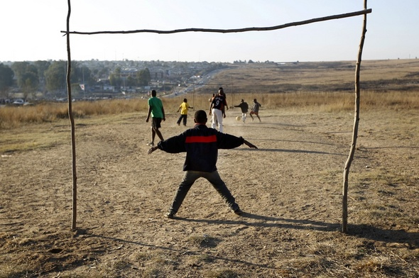 Kids soccer south african boys play soccer in a field in the