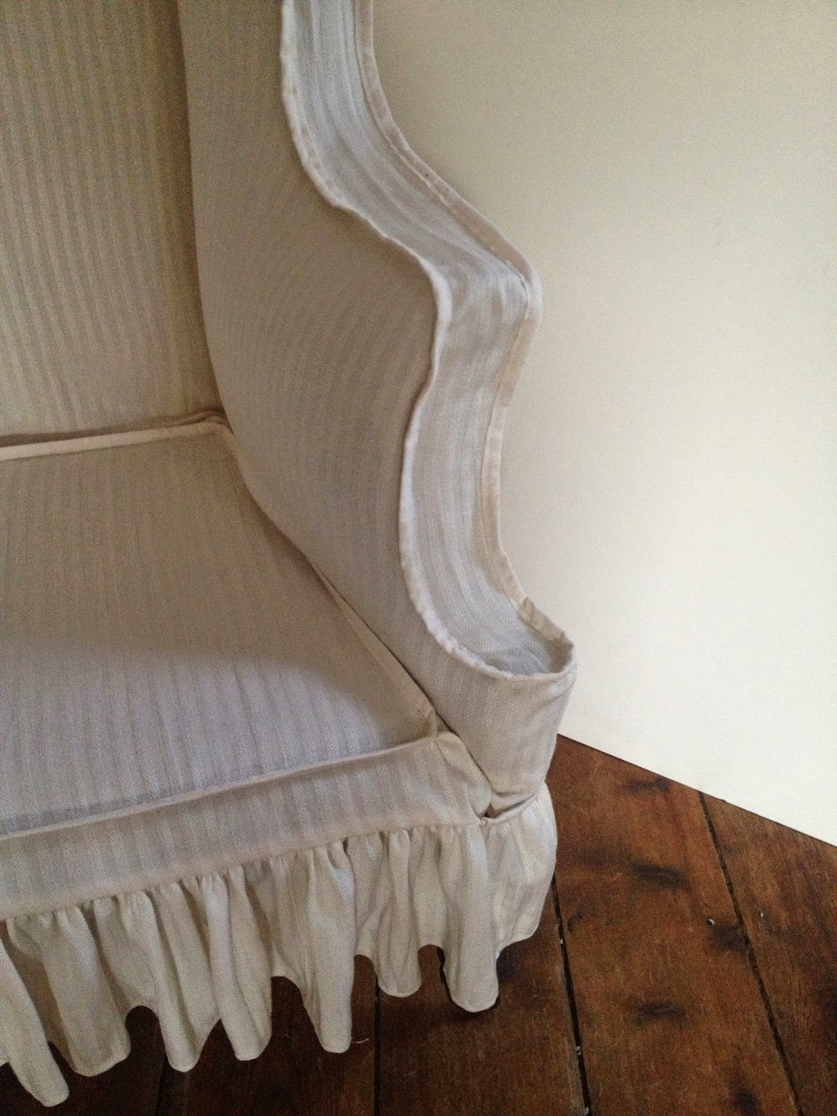 The historic chair after reupholstery in custom made reproduction fabric, textile conservator Gwen Spicer performed the work.
