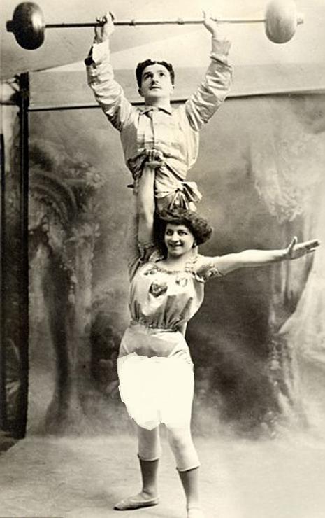 a strongwoman holds her partner aloft c 1910 vintage