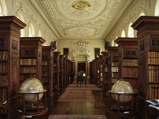 A corridor of book shelves at Trinity College.