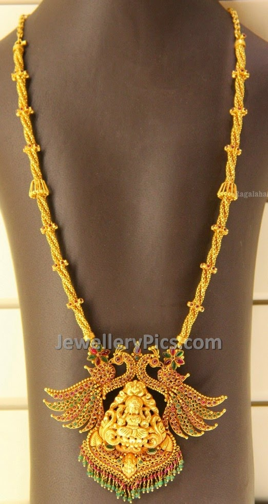 rope like gold chain with ruby emerald studded peacock pendent