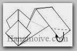 Bước 14: Gấp cạnh giấy vào  trong giữa hai lớp giấy.