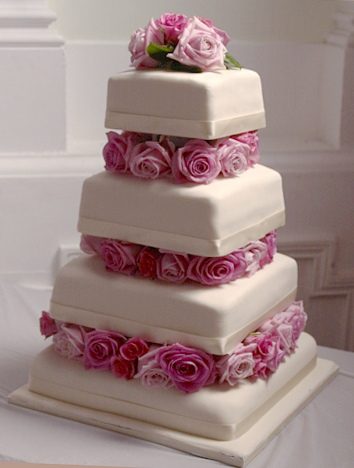 Wedding Cakes With Roses Between Tiers
