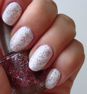 white nails with red sparkles