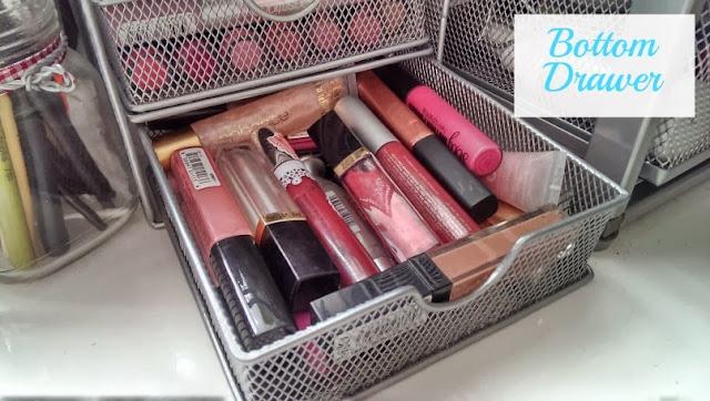 Bottom storage drawer for lip gloss