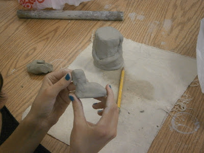 student assembling clay body for terra cotta warrior art lesson