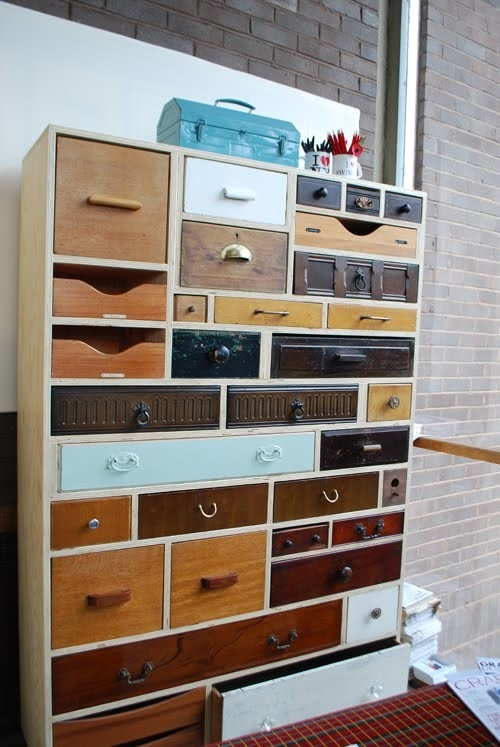 These creative repurposed drawers in different stains and colors are quirky.