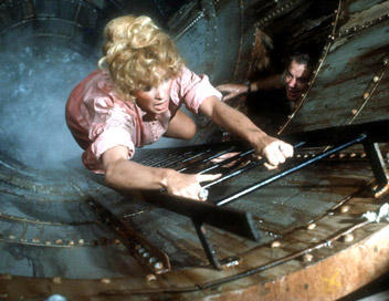 Stella Stevens climbing out of a maelstrom in The Poseidon Adventure