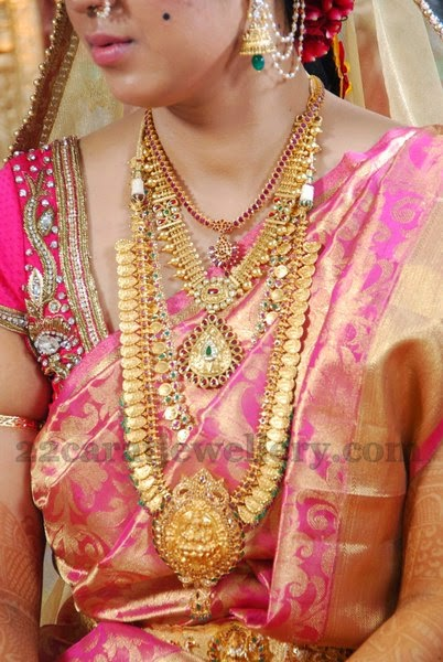Bride in Traditional Gold Jewellery - Jewellery Designs
