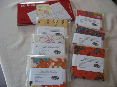 Shopping Loot - charm packs and Central Park Sudoku quilt kit