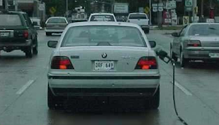 Funny pictures:  bmw with hose from gas station