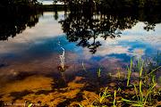 Just enjoying throwing rocks on the lake and taking pictures at 6:30 p.m. . (cheniere lake splash marked)