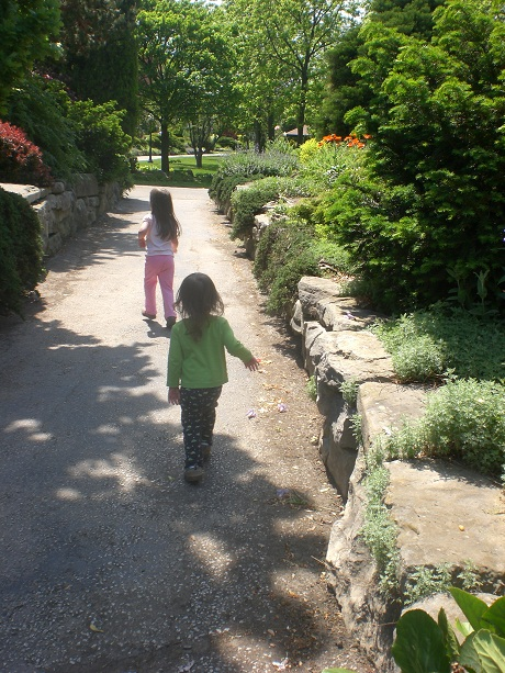 Two little girls Following the garden path.