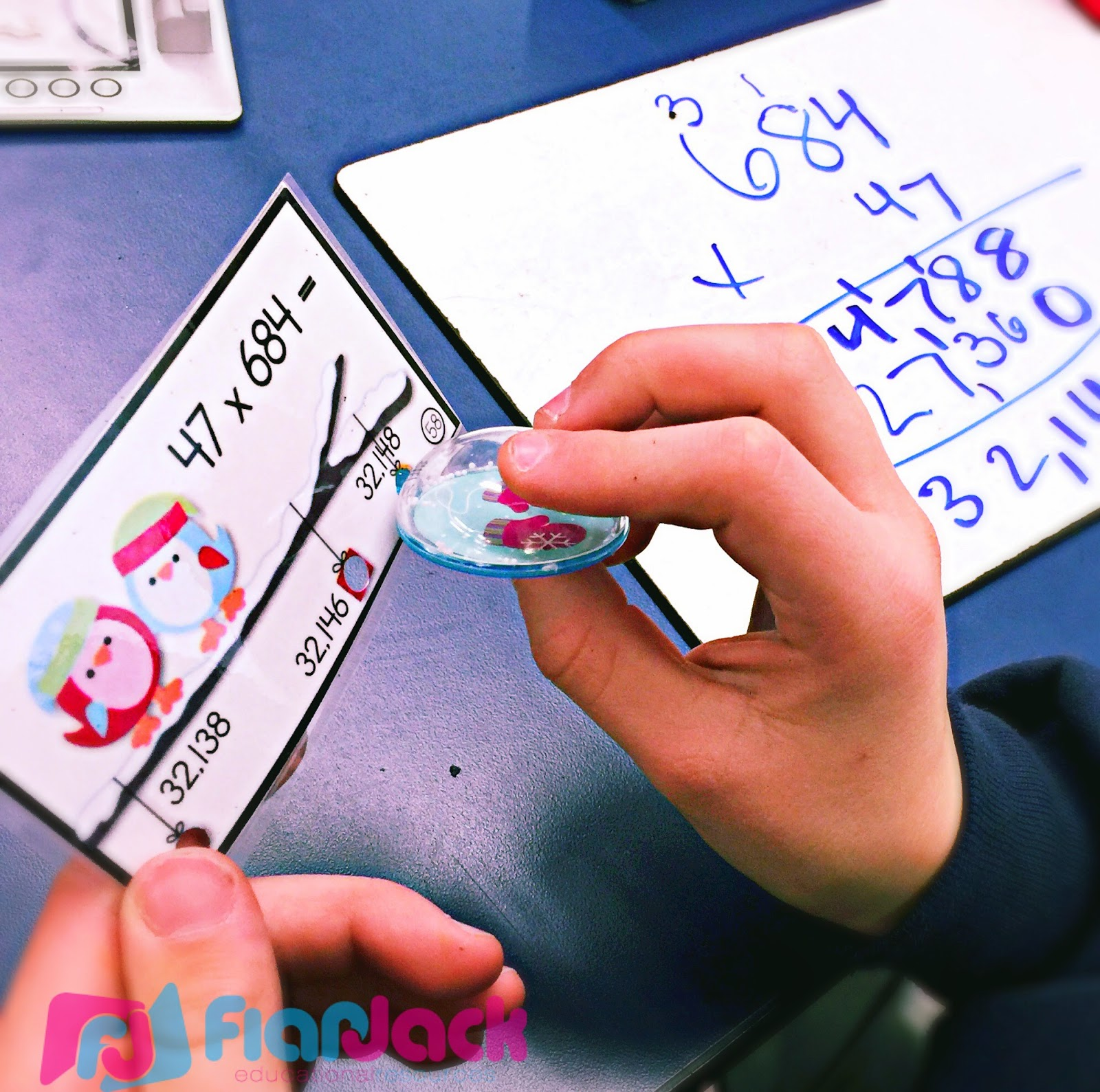 http://www.teacherspayteachers.com/Product/Winter-Multiple-Digit-Multiplication-Poke-Cards-1603112