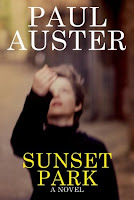 Sunset Park, a novel by Paul Auster. Blurry picture on cover shows a young blond boy wearing a black sweater, tossing something unseen into the air.