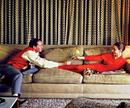 Mel Ferrer and wife, Audrey Hepburn at home.