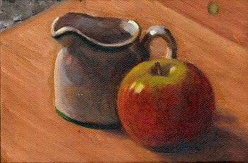 Oil painting of a white porcelain milk jug and a red and green apple on a wooden chopping board.