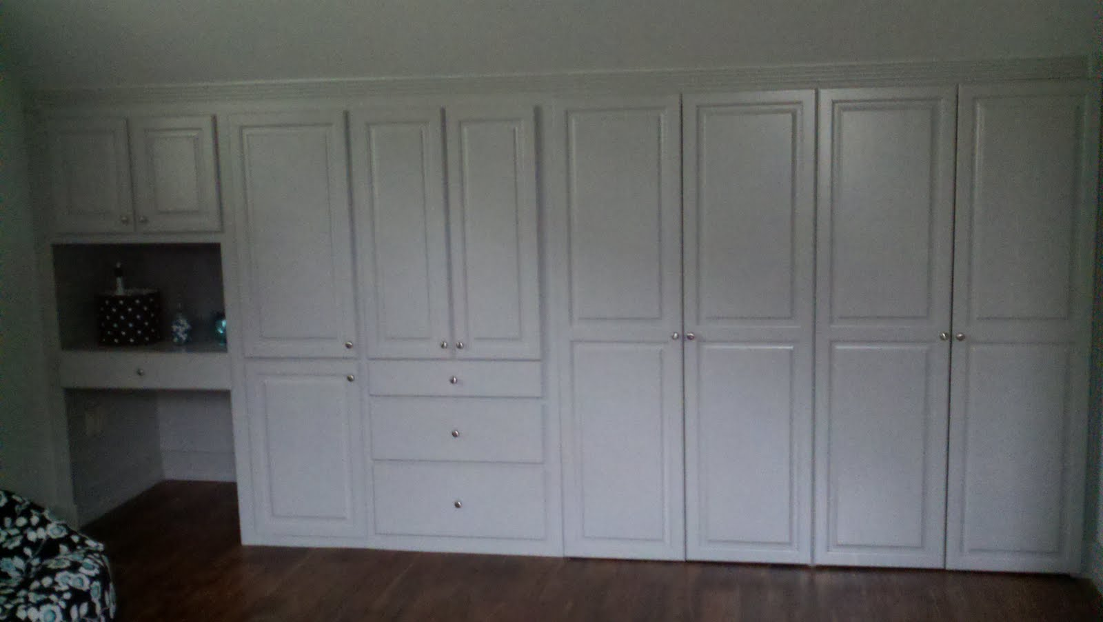 Homes renovations convert space into bedroom for Custom built cabinets